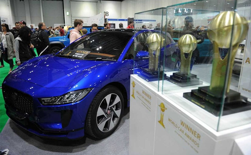 The World Car of the Year - Jaguar I-Pace with its three trophies on display
