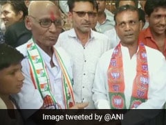 Congress Worker Loses Bet To BJP Worker, Gets His Head Shaved