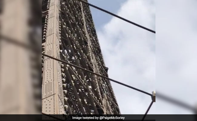 Eiffel Tower evacuated after climber scales monument