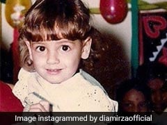 Can You Guess Who The 'Eighties Baby' In This Throwback Pic Is?