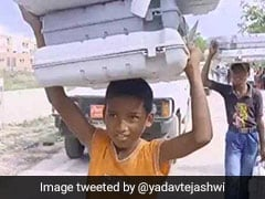 Lok Sabha Elections 2019: 'ইভিএম বয়ে নিয়ে যাচ্ছে শিশু শ্রমিকরা': তেজস্বী যাদবের আক্রমণ নির্বাচন কমিশনকে