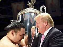 Trump Presents 'President's Cup' To Sumo Champion In Japan Trip Highlight