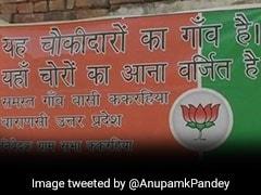 प्रधानमंत्री नरेंद्र मोदी के गोद लिए गांवे में लगे पोस्टर, लिखा- 'ये चौकीदार का गांव है, कोई चोर न आना...'