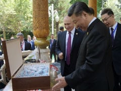 Vladimir Putin Gives China's Xi Jinping Ice Cream On His 66th Birthday