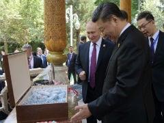 Vladimir Putin Gives China's Xi Jinping Ice Cream On His 66th Birthday