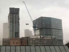 1 Dead, 6 Injured After Crane Collapses On Apartment Building In US