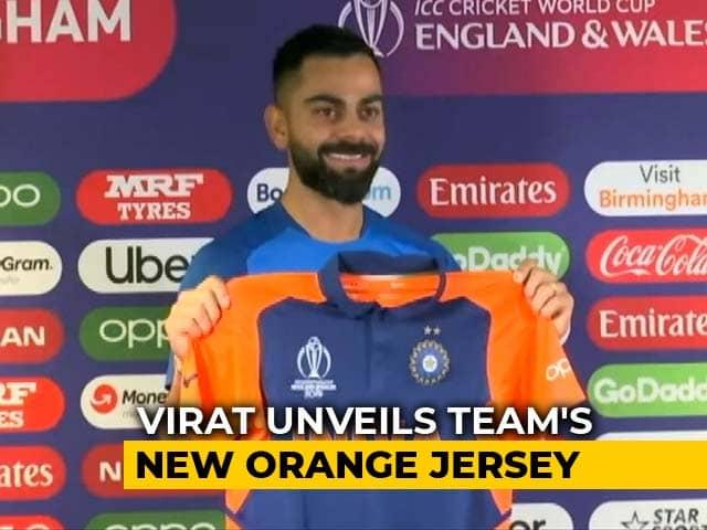 Virat Kohli Unveils Indian Teams New Orange Jersey