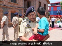 Policeman Carrying Killed Cop's 4-Year-Old Son Breaks Down During Homage