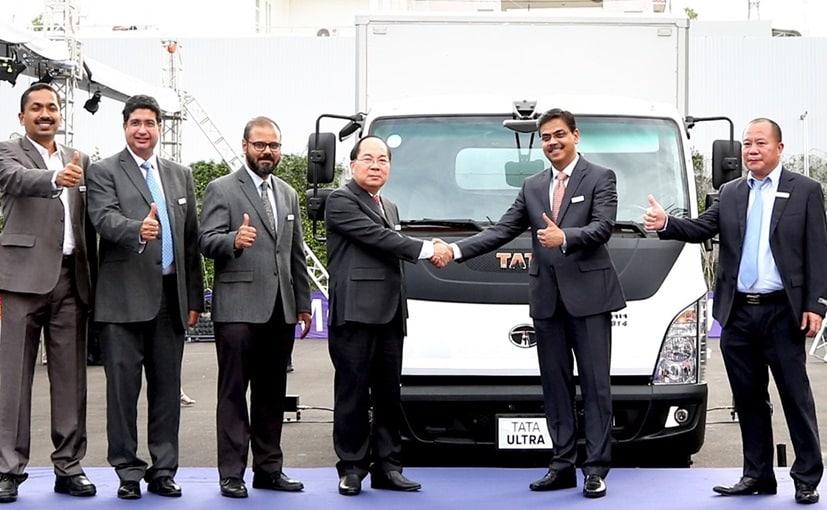 Bui Van Huu Chairman, TMT Group & Girish Wagh, President CV, Tata Motors, and others with the Tata Ultra