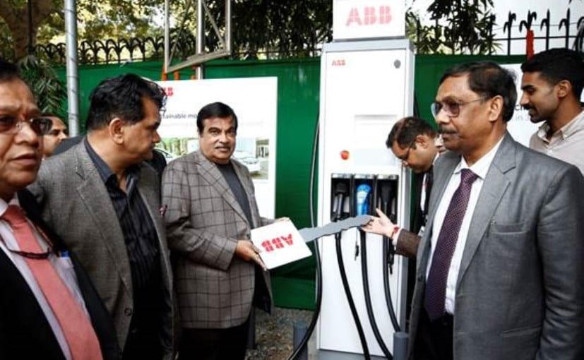 Minister for Road Transport & Highways Nitin Gadkari with ABB officials with the new fast charger