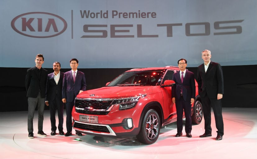 The Kia Seltos at the global unveil event with the Kia Motors management