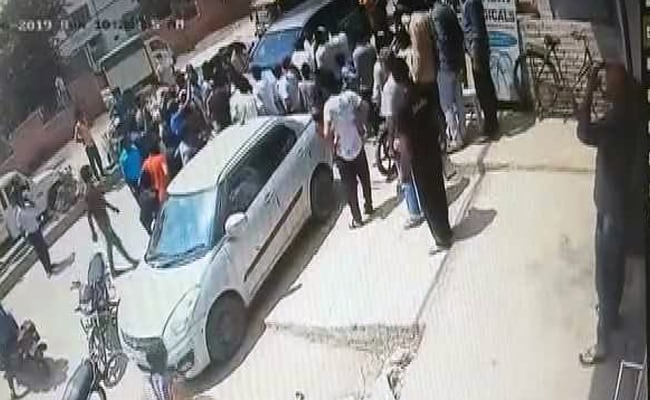 Homeguard Officer Dragged On BJP Leader's Car In Haryana