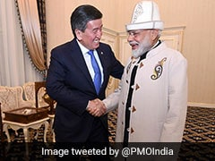 PM Receives Traditional Kyrgyz Hat, Coat As Gifts By President Jeenbekov