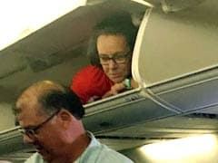 Flight Attendant In Overhead Compartment Shocks Passengers