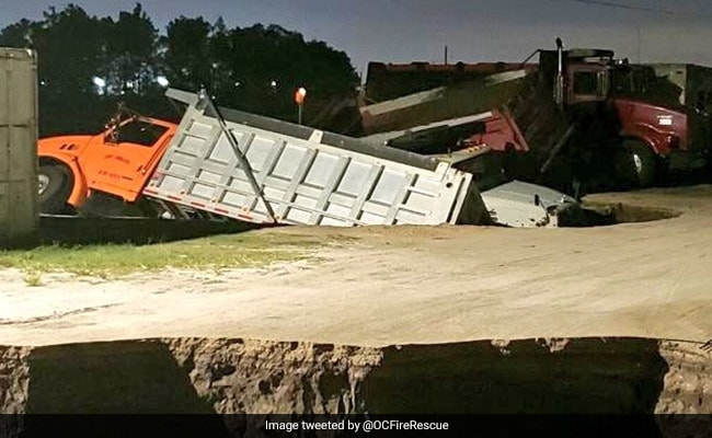Massive Holes Open Up Suddenly On Road, Swallow Several Trucks. See Pics