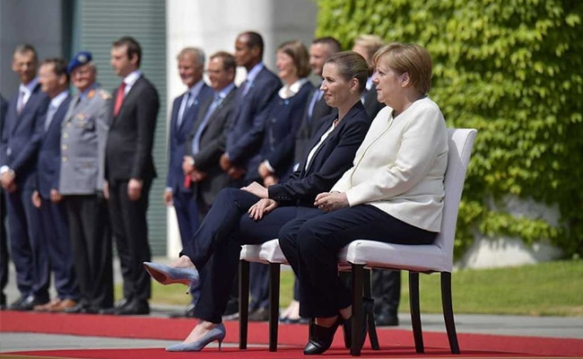 Germany's Merkel sits for anthems after shaking episodes