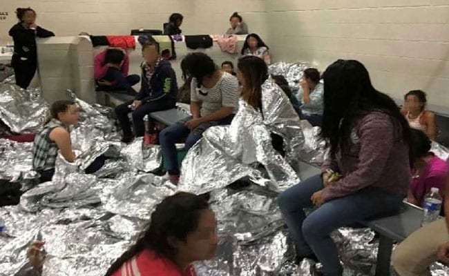 'Help, 40 Days Here': Photos Show Migrants Crammed Into US Border Centres
