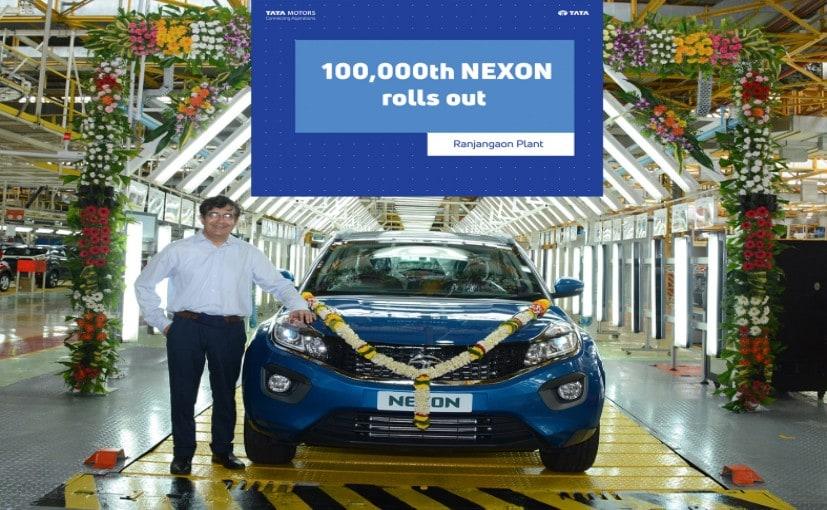 Mayank Pareek, President- PV Division at the Ranjangaon plant alongside the 100,000th Tata Nexon.
