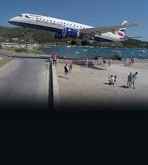 Hair-Raising Video Shows Plane Landing Just A Few Feet Away From Tourists