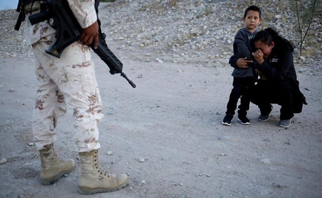 Photo Captures Guatemalan Mother Begging Soldier To Let Her Enter US