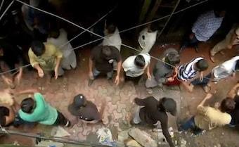 Human Chain To Remove Debris In Search For Survivors In Mumbai's Dongri