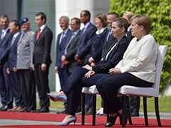 Germany's Angela Merkel Sits Through National Anthems After Shaking Spells