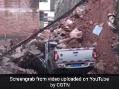 Woman's Narrow Escape As Wall Collapses, Buries Cars