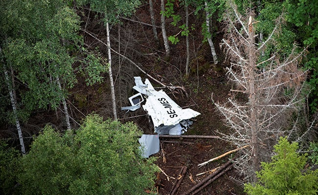 Wreckage of the skydiving GippsAero Airvan aircraft lying in the woods of Storsandskar island.