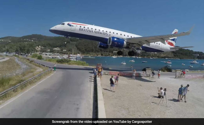 Hair-Raising Video Shows Plane Landing Just A Few Feet Away From Tourists