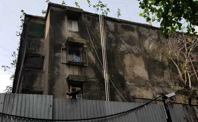 """Image result for Mumbai:The death of 14 people in a building collapse in Mumbai's Dongri on Tuesday has yet again highlighted how people in the city continue to live in dilapidated homes that are on the verge of collapse.In the city, where people say that finding god is easier than finding a home, residents continue to stay in unsafe buildings even if it means risking their lives. In several cases, the buildings are illegal and in many cases, the residents cannot afford redevelopment.In May, 499 buildings in Mumbai, the financial capital of the country, were identified as """"dangerous"""" by the BMC or Brihanmumbai Municipal Corporation.While some were later cleared as these buildings met the safety norms; in most buildings, people simply refused to move out.NDTV conducted a reality check in two buildings and a chawl, which according to the BMC, should be brought down immediately as they could collapse any time.In Sewri, 317 families living in the Veena Beena Cooperative Housing Society say they will carry out repairs as redevelopment is not feasible. Lack of trust in builders, fear of losing a home and a terrible transit accommodation are some of the reason that they give for not choosing redevelopment as an option.Joseph Lewis, secretary of Veena Beena Cooperative Housing Society, told NDTV, """"There are several doubts because the lobby of builders is very powerful and when builders don't complete their projects on time, people are forced to live in transit camps and that is why people are afraid to go for redevelopment though the buildings are old. They feel safe staying in the old buildings rather than shifting.""""After Tuesday's building collapse, the government is looking into the hurdles of redevelopment.Chief Minister Devendra Fadnavis held a meeting with top officials on Wednesday to see how the buildings in the C1 category, which have been identified as """"very dangerous"""", can be redeveloped without delay.The current redevelopment policy is prohibitively expensive wh"""