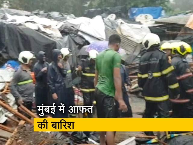 Videos : मुंबई: भारी बारिश के कारण मलाड में दीवार गिरी, 14 लोगों की मौत