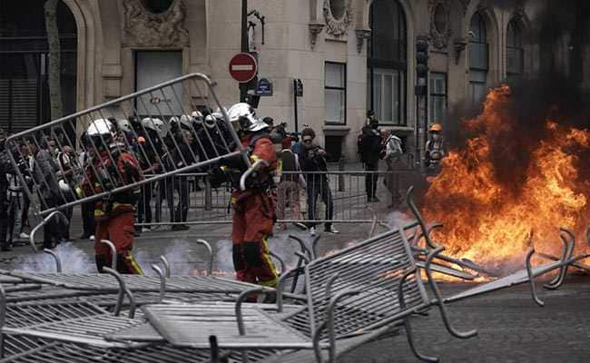 Cops, Protesters Clash In Paris During France's National Day Celebration