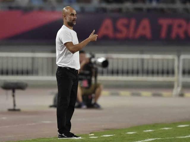 "Glum Pep Guardiola Says Manchester Citys China Visit Mere ""Survival"""