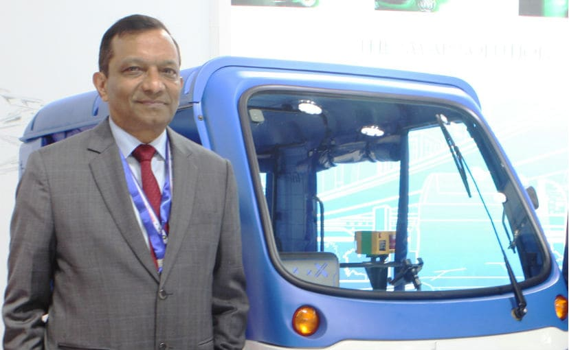 Dr. Pawan Goenka with the Mahindra Treo - the manufacturer's first electric three-wheeler
