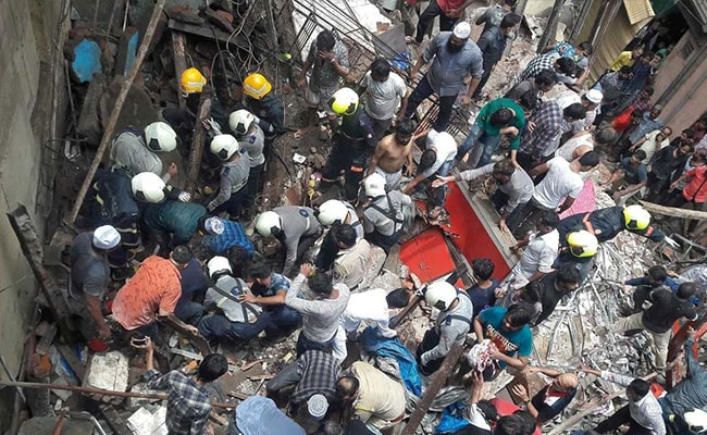 Four storey building collapses in India - 40 feared trapped