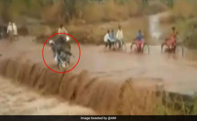 On Video, Biker Falls Off Flooded Road In Madhya Pradesh; Survives