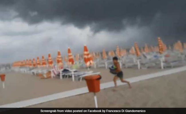 Video: Visitors Flee Beach As Severe Storm Sends Debris Flying