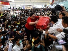 Hong Kong Airport Cancels All Departures As Protesters Squat Inside
