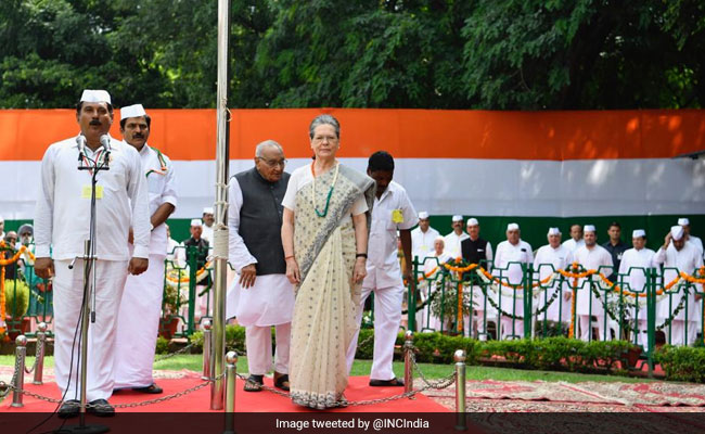 Sonia Gandhi Unfurls National Flag At Congress Headquarters