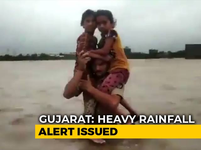 Video : Gujarat Cop Carries 2 Girls Through Waist-Deep Floodwater, Wins Praise