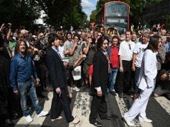 Beatles Fans Come Together For 50th Anniversary Of Iconic Abbey Road Photo