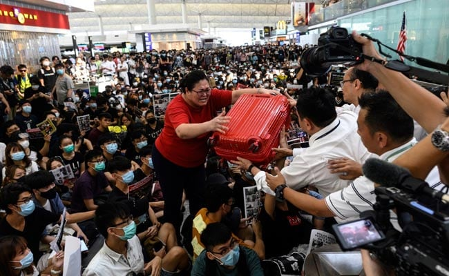 China slams 'terrorist-like actions' by protesters at Hong Kong airport