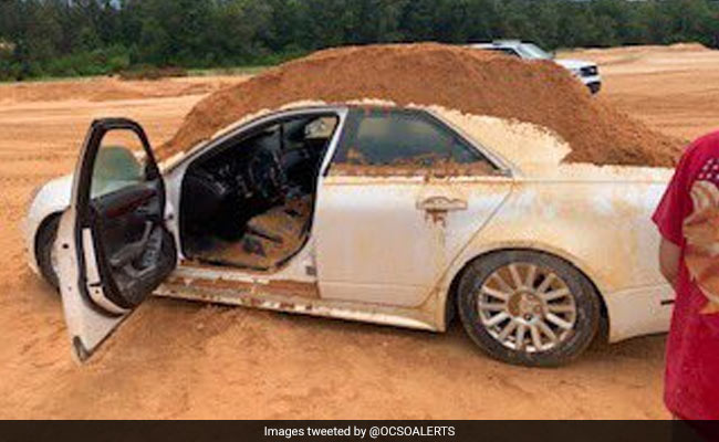 Man Arrested For Dumping Dirt On Car. His Girlfriend Was Inside