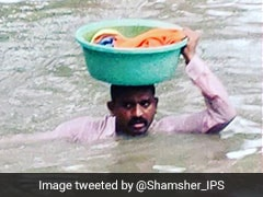 Vadodara Cop Carries 2-Year-Old In Tub On His Head In Neck-Deep Water