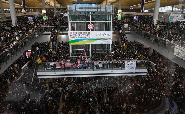 Protesters Shut Down Hong Kong Airport; China Warns Of 'Terrorism'