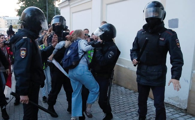 Shocking video shows Russian policeman punching female protester
