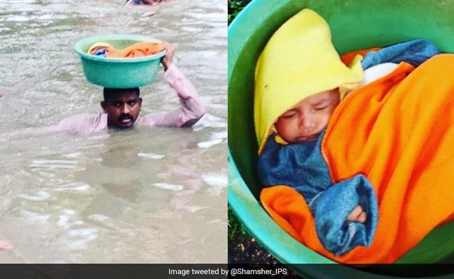 Vadodara Rain: 2 साल की बच्ची को बचाने के लिए पुलिसकर्मी गले तक भरे पानी में उतरा, फिर टब में रखकर यूं बचाई जान