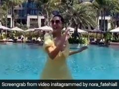 स्विमिंग पूल के पास मस्ती में झूमती नजर आईं नोरा फतेही, वायरल हुआ धांसू Video