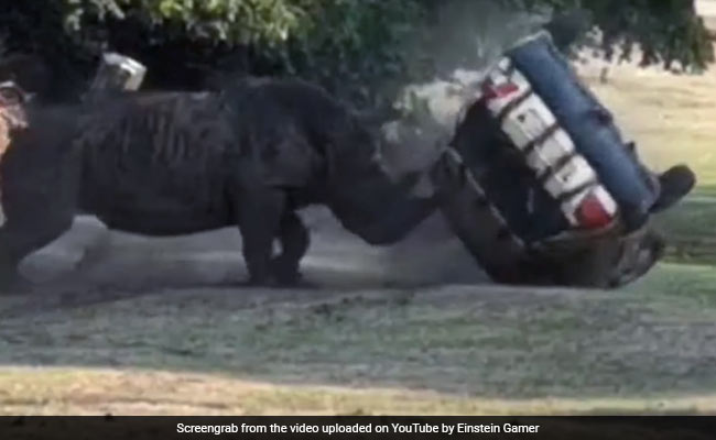 On Camera: Angry Rhino Attacks Car, Flips It Over Three Times