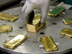 Gold Prices Hit Record High On Safe-Haven Rush, Weak Rupee